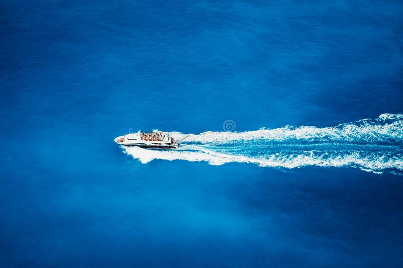 Top view of tourist boat sailing in the sea on full speed.  stock images