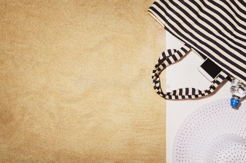 Top view towel on sandy beach. Background with copy space royalty free stock photo