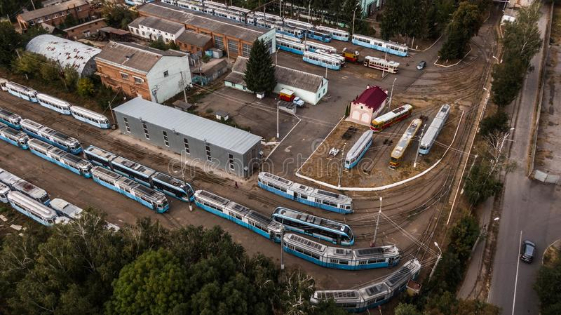 Top view of a tram depot in the open air. Trams stand in a row, one after another, of different models and years of release. Night royalty free stock photography