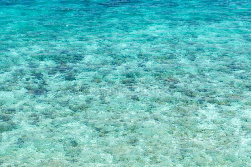 Sea surface wit rock aerial stock photos