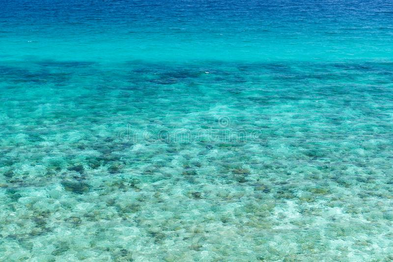 Sea surface wit rock aerial stock images
