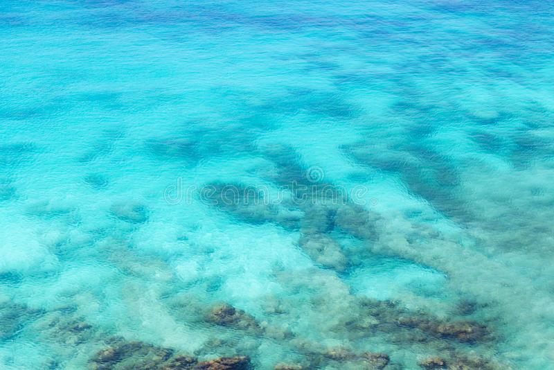 Sea surface wit rock aerial stock image