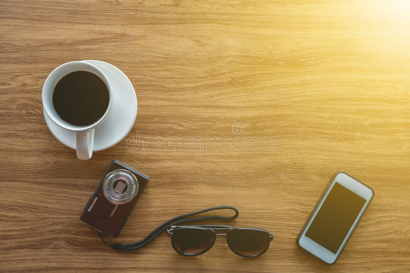 Top view, Travel stuff and accessories on wooden table royalty free stock images