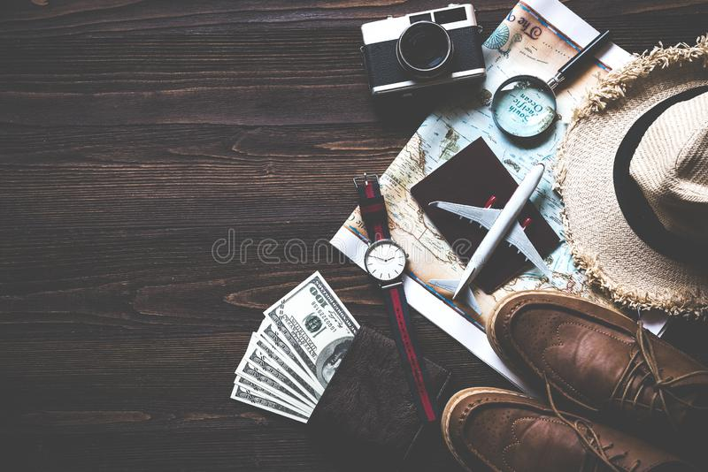 Top view of Traveler accessories and items man with black for planning travel vacations on the world, copy space. stock photography