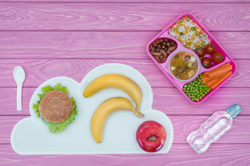 top view of tray with kids lunch for school, burger and fruits stock photo