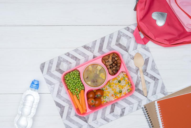 top view of tray with kids lunch for school and copybooks stock photography