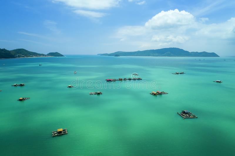 Top View Tropical Island , Aerial view of long-tailed boat on the sea. In Phuket Thailand stock photos
