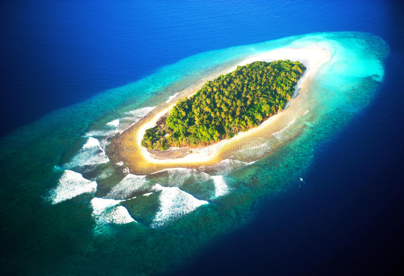 Top view of tropical island, turquoise blue water stock photography