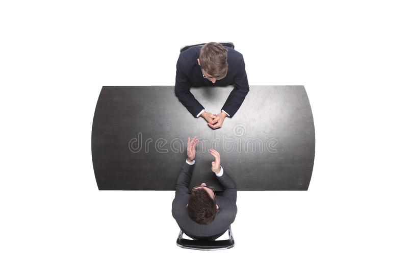 Top view. two business people discussing something at a meeting royalty free stock photos