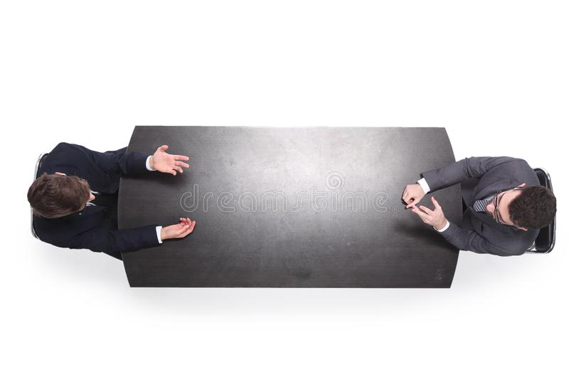 Top view. two business people discussing something at a meeting royalty free stock images