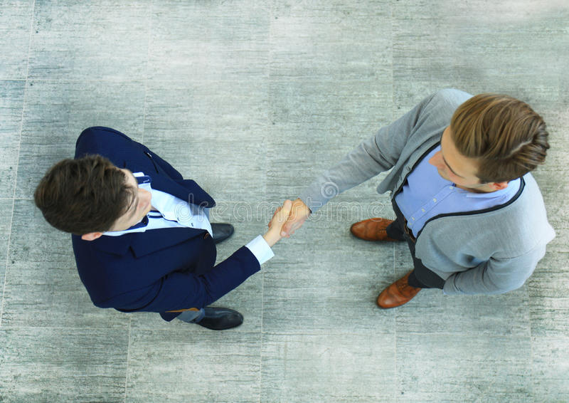 Top view of a two businessman shaking hands. Welcome to business. royalty free stock photo
