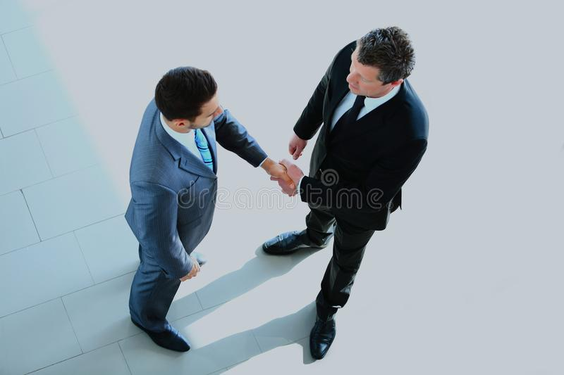 Top view of a two businessman shaking hands - Welcome to business. stock image