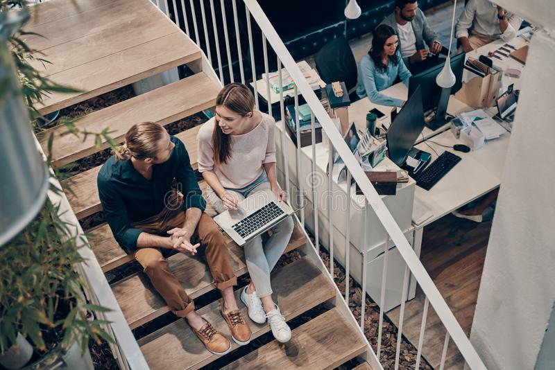 Top view of two young modern colleagues in smart casual wear royalty free stock image