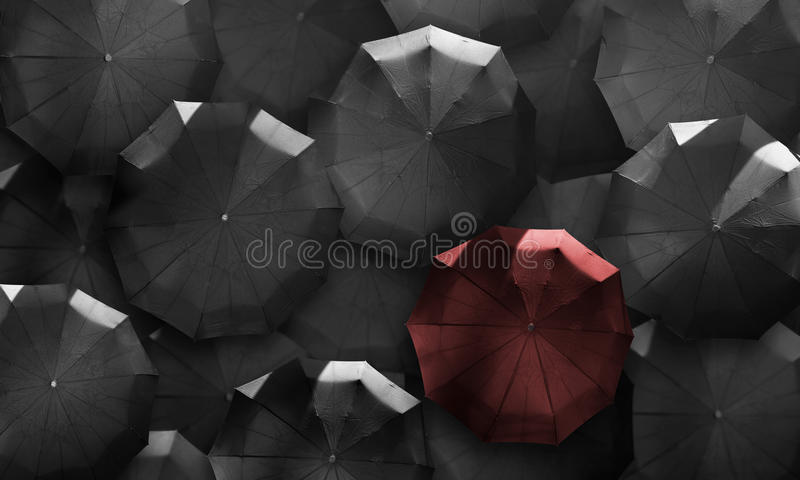 Top view umbrellas. Red in mass of black. Stand out from the cro. Stand out from the crowd. Red umbrella in mass of black stock photos