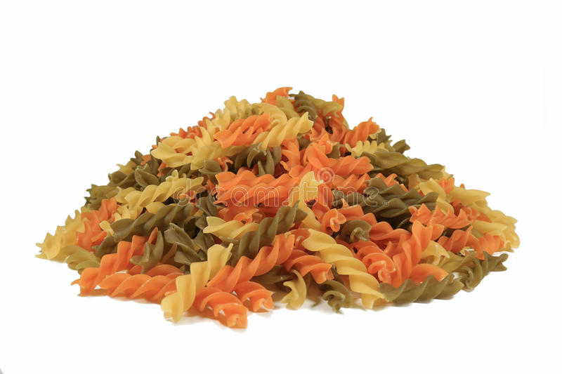 Top View of Uncooked Tricolor Fusilli, Three-Color Spiral Shaped Pasta royalty free stock photography