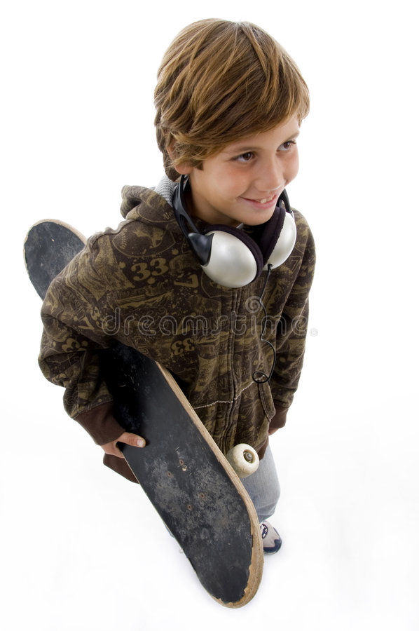 Top view of urban kid holding skateboard royalty free stock images