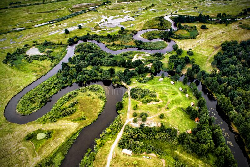 Top view of the valley of a meandering river among green royalty free stock images