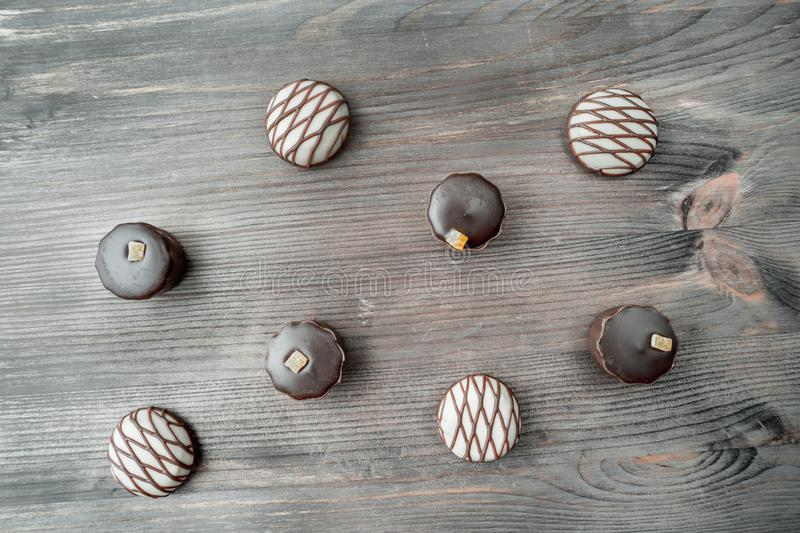 Top view of various chocolate candies on wooden background royalty free stock photo