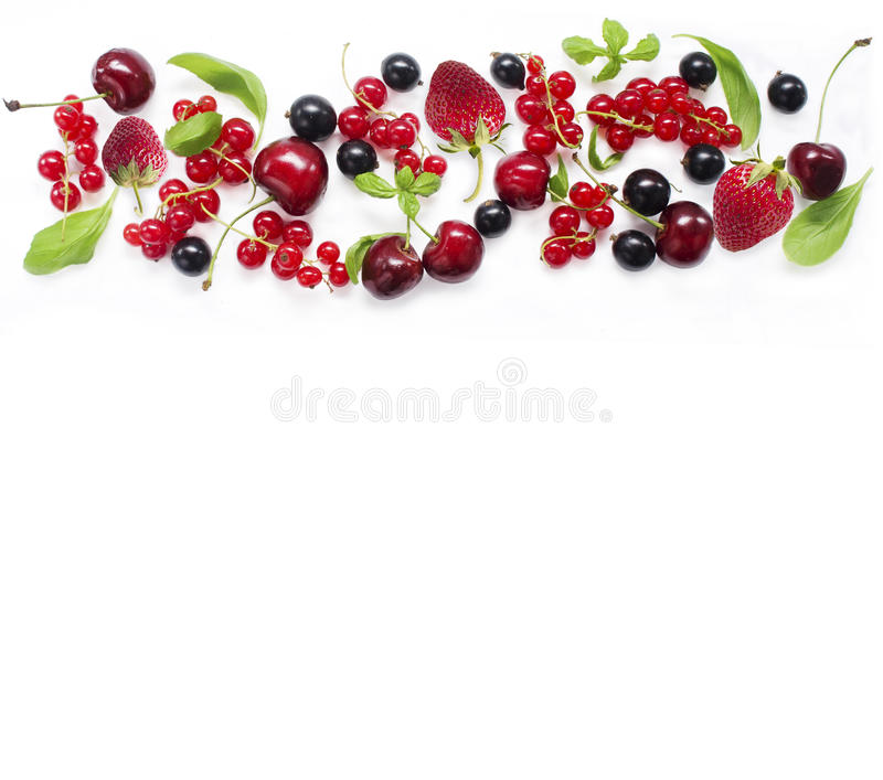 Top view. Various fresh summer berries on white background stock photo