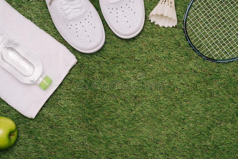 Top view of various sport equipment on green grass royalty free stock image
