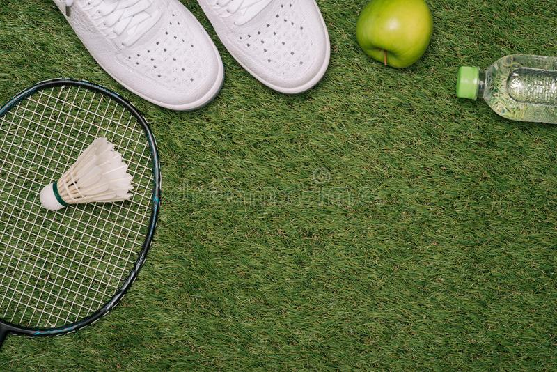 Top view of various sport equipment on green grass stock image