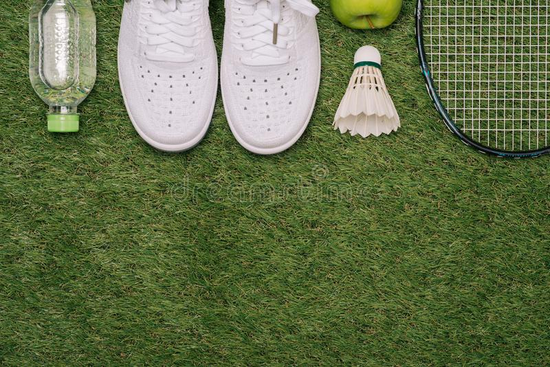 Top view of various sport equipment on green grass royalty free stock photography