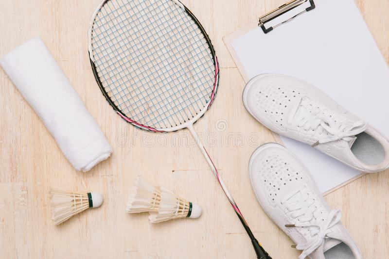 Top view of various sport equipment on white surface stock photography
