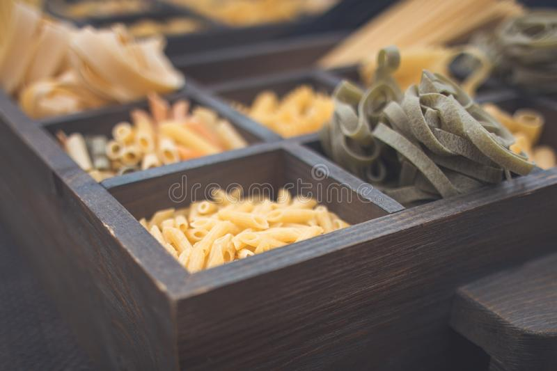 Top view Various types of Italian pasta rustic background stock images