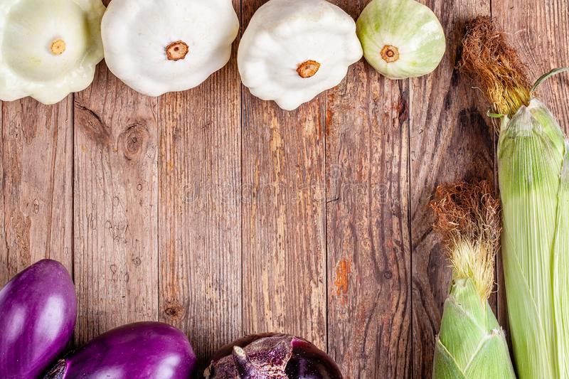 Top view of vegetables on wood with copy space. Organic vegetarian food. Top view of vegetables on wood with copy space. Healthy food - corn, eggplants and royalty free stock image