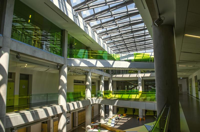 Top view of the vestibule with natural daylight from under the glazed frames, ceiling in the international College in Dilijan royalty free stock image