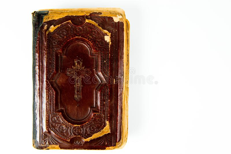 Top view on vintage book with claret leather cover with christian cross. On white background royalty free stock photo
