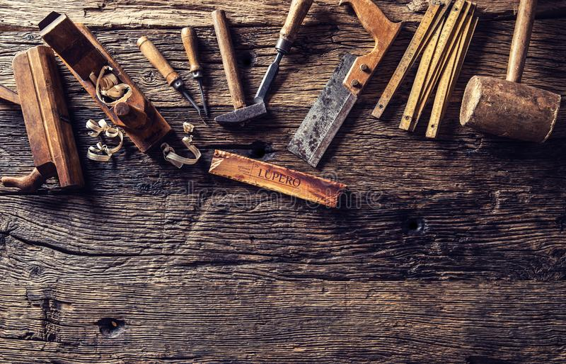 Top of view vintage carpenter tools in a carpentry workshop royalty free stock photo
