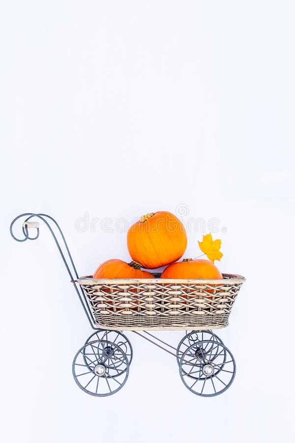 Top view Vintage Garden carriage basket with ripe pumpkins on the white background isolated . Autumn harvest, thanksgiving, hallow royalty free stock photo