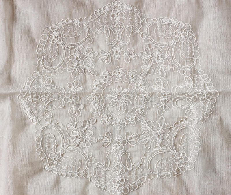 Top view of vintage hand made beautiful lace fabric over wooden table.  stock photography