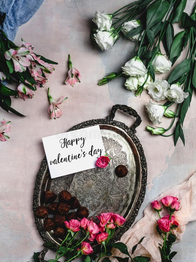 Top view of vintage tray with chocolate candies, flowers and Happy valentines day. Greeting card royalty free stock photos