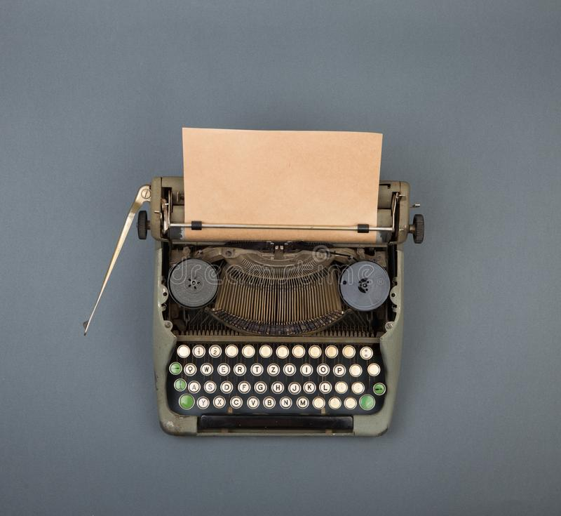 Top view of vintage typewriter on grey table. Old, machine, author, letter, antique, background, blog, desk, keyboard, office, page, paper, print, publish stock photography