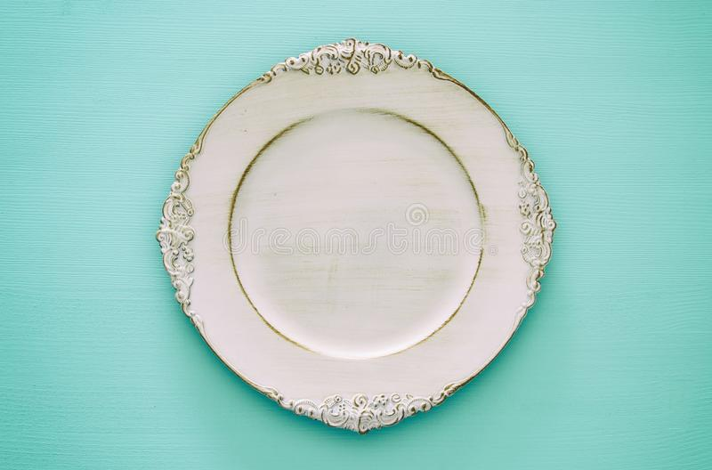 Top view of vintage white empty plate. Flat lay. royalty free stock images