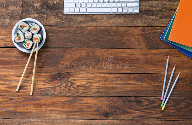 Top View of Vintage wooden Table with Computer and Food. Top View of Vintage handmade Wood Table with Business and Lifestyle Items Computer Keyboard Color royalty free stock photos