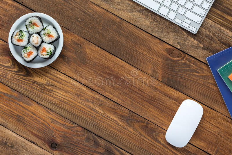 Top View of Vintage wooden Table with Computer and Food. Top View of Vintage handmade Wood Table with Business and Lifestyle Items Computer Keyboard Mouse stock images