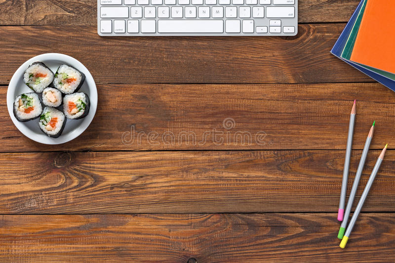 Top View of Vintage wooden Table with Computer and Food. Top View of Vintage handmade Wood Table with Business and Lifestyle Items Computer Keyboard Pencil royalty free stock photos