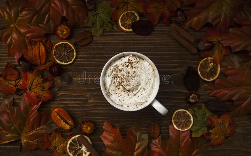 Top view of warm cup of coffee with autumn details stock photo