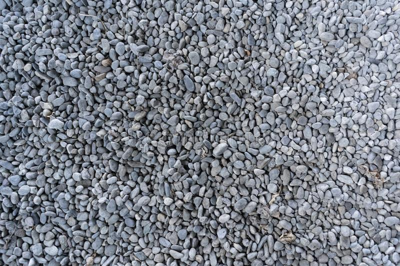 Top view on washed gravel in blue gray, size 10-12 mm, laid out on the ground. View from above on washed gravel in blue gray, size 10-12 mm, laid out on the royalty free stock photo
