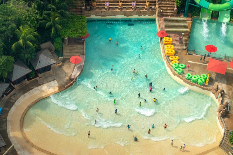 Top view of water park with many traveler have fun swimming pool in Sentosa, Singapore royalty free stock photo