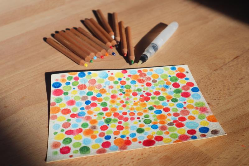 Top view of watercolor paints on a wood table royalty free stock image