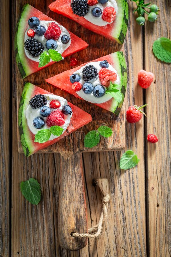 Top view of watermelon pizza with cream and fresh fruits royalty free stock photo