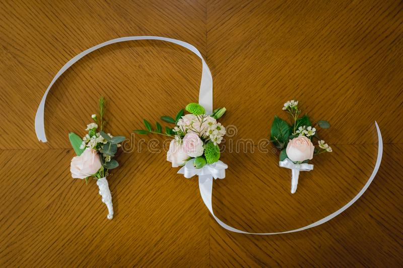 Top view of wedding boutonniere for the groom and bridesmaids on wooden background, free space. copy space. royalty free stock photography