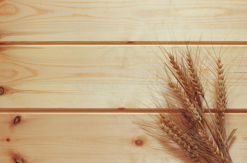 Top view of whet crop on wooden table stock photo