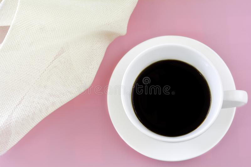Top view White cup of black coffee on pink background with copy space. Freshness in morning concept. White cup of black coffee on pink background. Freshness in stock image