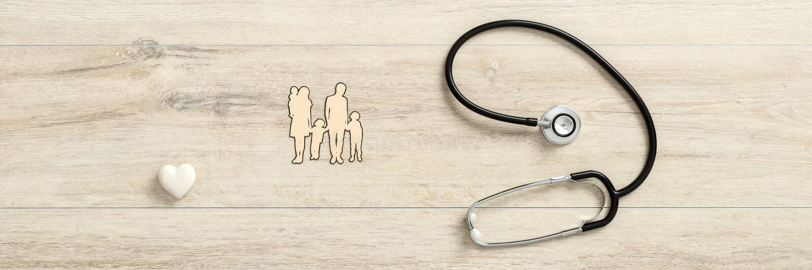White heart with medical stethoscope next to a family royalty free stock image