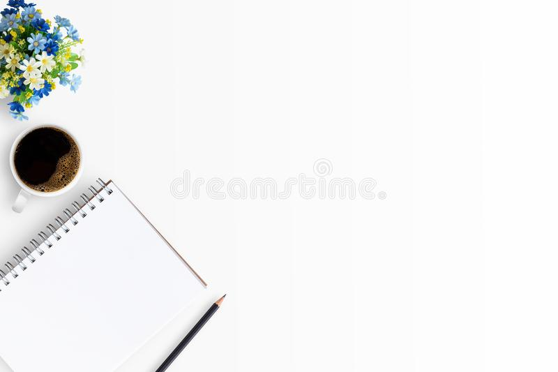 Top view of white office table or office desk with blank notebook stock photography